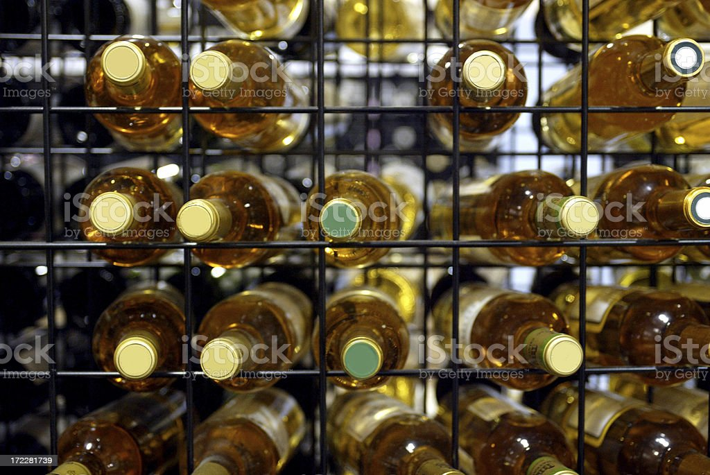 White wine bottles on a wire rack royalty-free stock photo