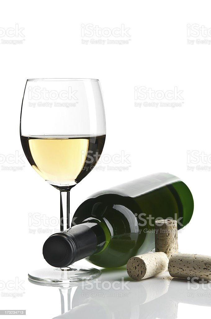 White wine glass with bottle isolated royalty-free stock photo
