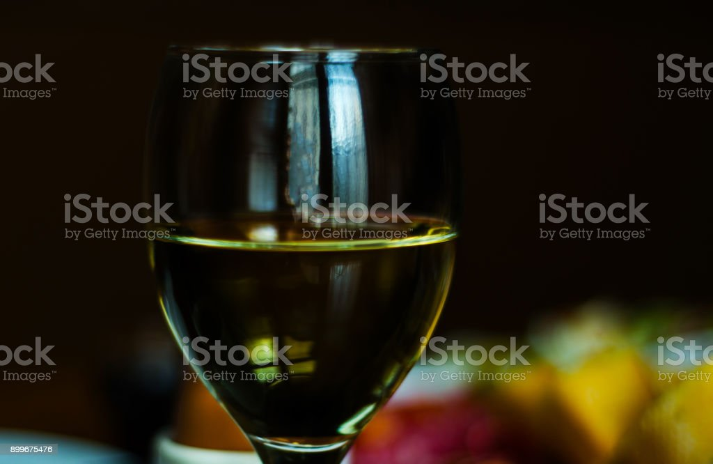 white wine in a glass with appetizers on a wooden table, a set of starters, relax with a glass of wine, stock photo