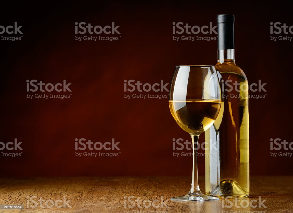 white wine in glass and bottle stock photo