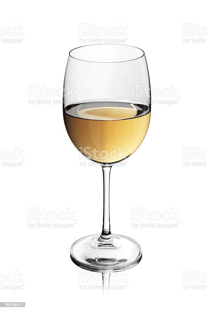 White wine in glass half full royalty-free stock photo