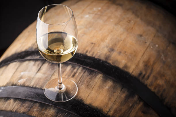 white wine on a barrel - moldova stock pictures, royalty-free photos & images