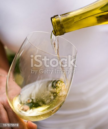 White wine pour. macro, shallow focus.