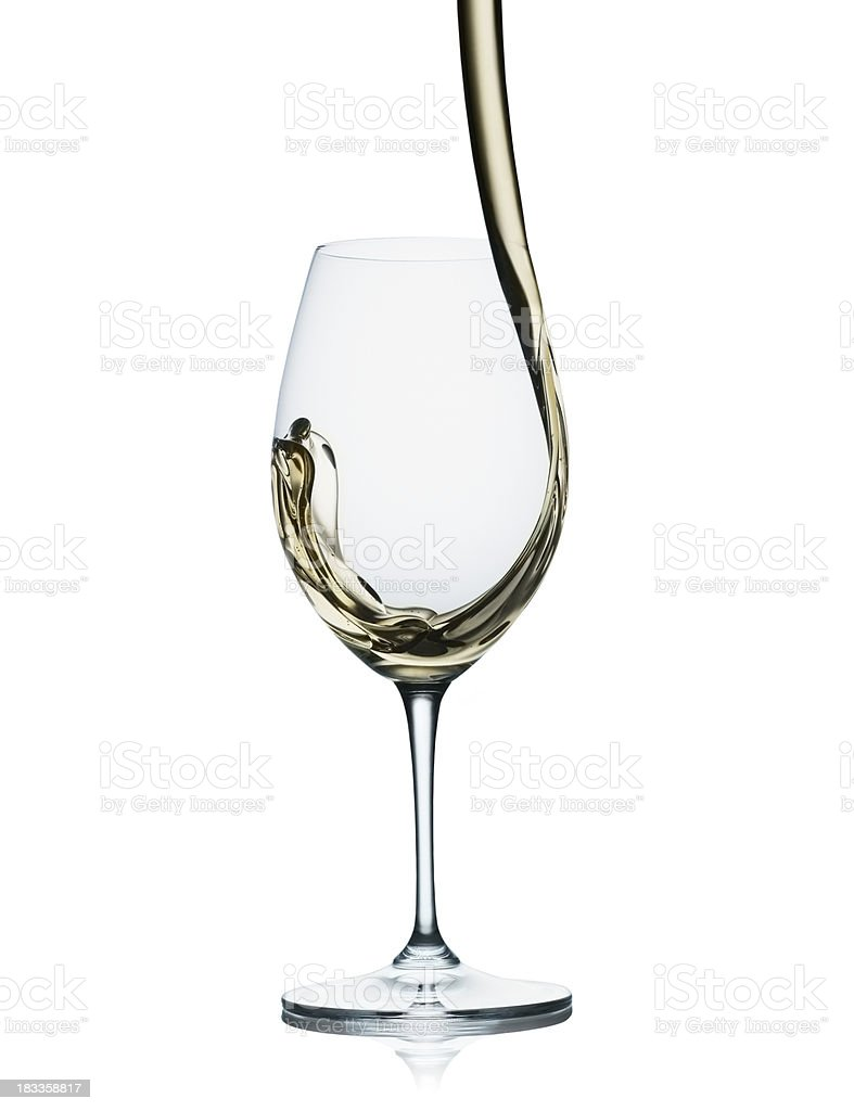 White wine pouring into glass royalty-free stock photo