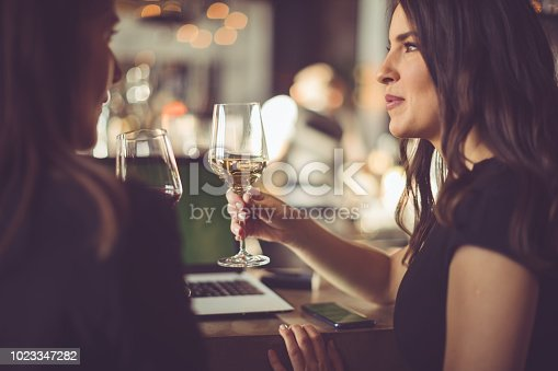 Two women tasting wine in a bar