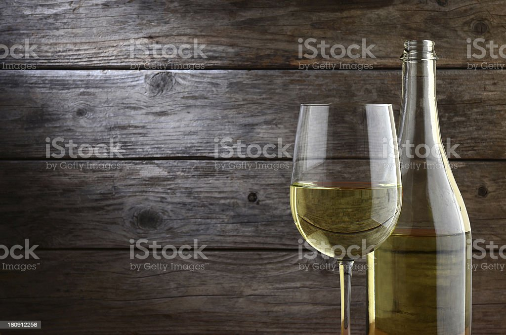 White wine with rustic wooden background royalty-free stock photo
