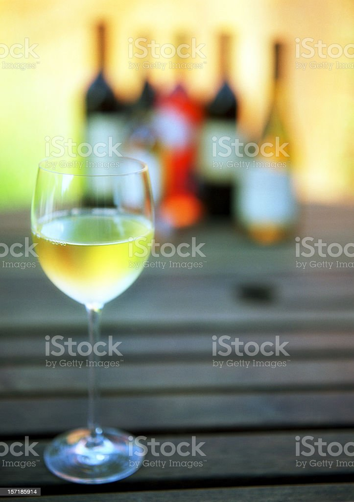 White wine with wine bottles royalty-free stock photo