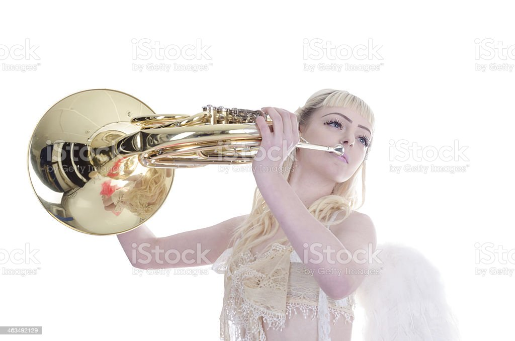 White winged cherub playing brass instrument. royalty-free stock photo