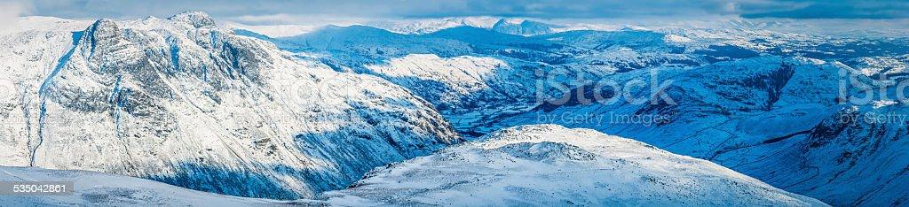 White winter landscape snowy mountain peaks panorama Lake District Cumbria stock photo