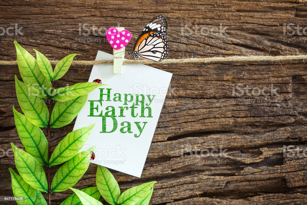 white with Happy Earth Day paper note hanging stock photo
