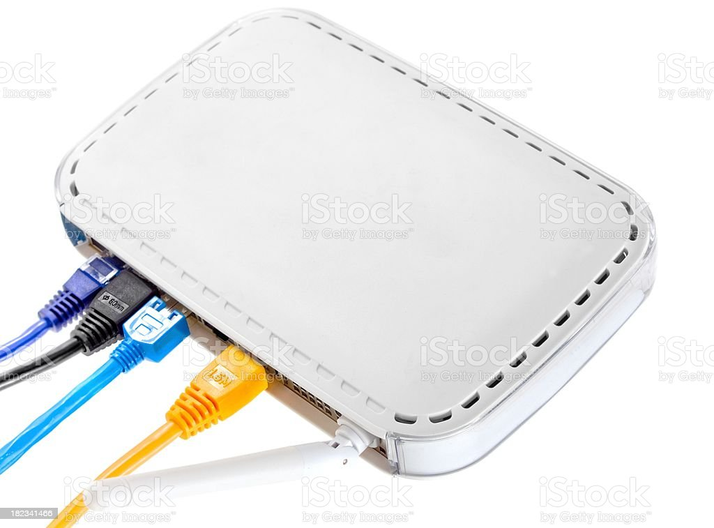 white wlan router with colorful pluggeg in cables stock photo