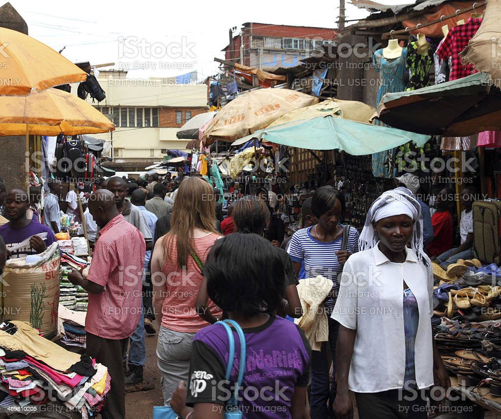 White Woman in African Market Shopping stock photo