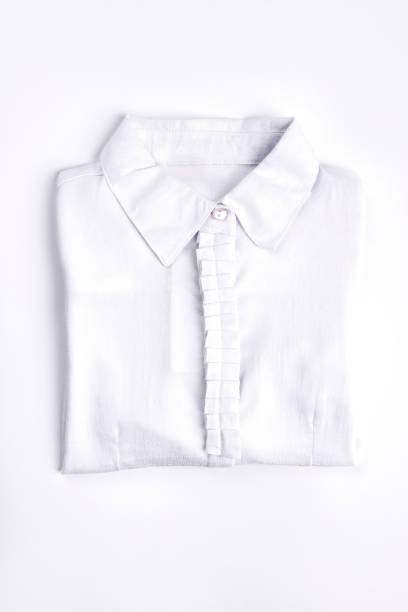 White woman shirt on white background. White woman shirt on white background. New folded cotton blouse for school girls. New collection of modern cotton shirts for girls. blouse stock pictures, royalty-free photos & images