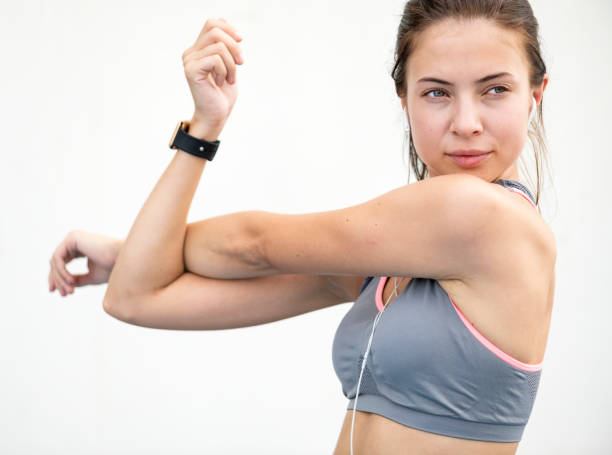 White woman stretching before exercise stock photo