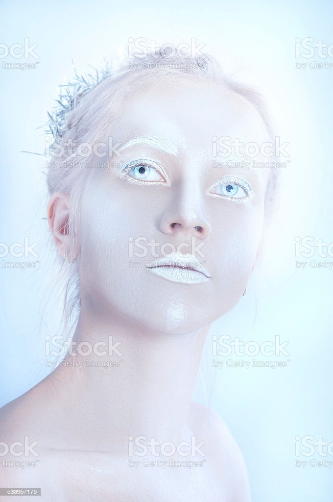 White woman with transparent eyes and white makeup stock photo