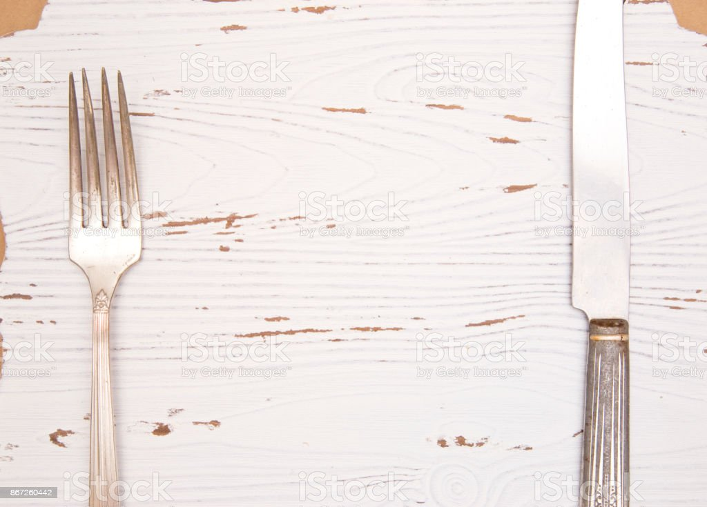 White Wood Background with Knife and Fork stock photo