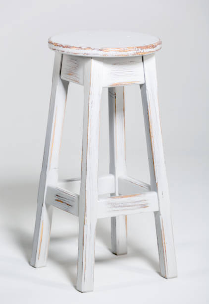 White Wood Bar Stool White retro wood bar stool on a white background. Studio shooting stool stock pictures, royalty-free photos & images