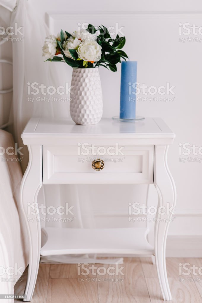 Picture of: White Wood Bedside Table Dresser In Bedroom Bouquet On The Nightstand Vase With Flowers Candle Interior Series Of Furniture Modern Designer Vintage Style Short Cabinet With Drawer In The Room Stock Photo