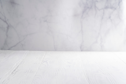 White wood board table with white marble background copy space empty blank