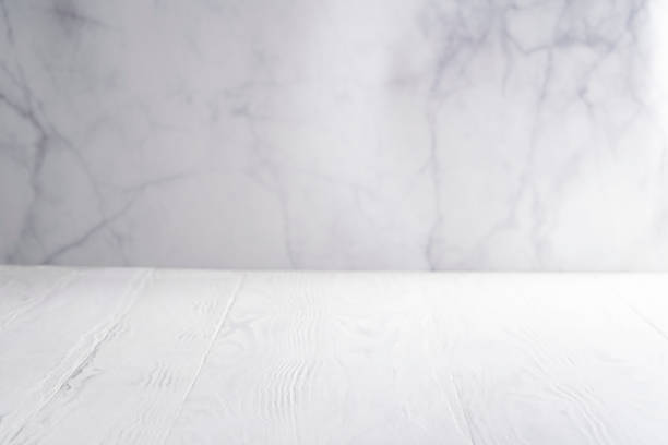 White wood board table with white marble background copy space White wood board table with white marble background copy space empty blank white marble stock pictures, royalty-free photos & images