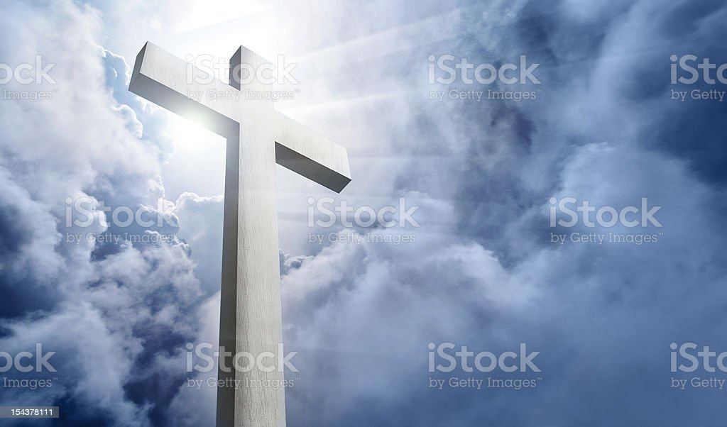 white wood cross and cloudy sky stock photo