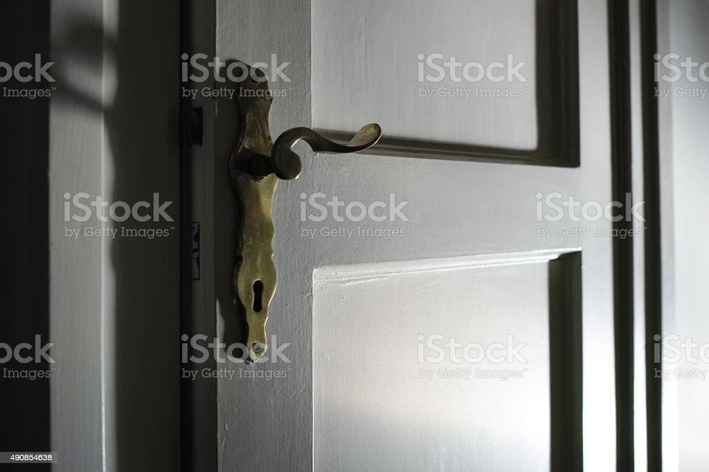 White Wood Door With Golden Door Handle stock photo