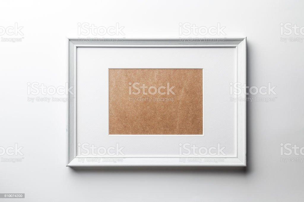 White wood frame on white wall stock photo