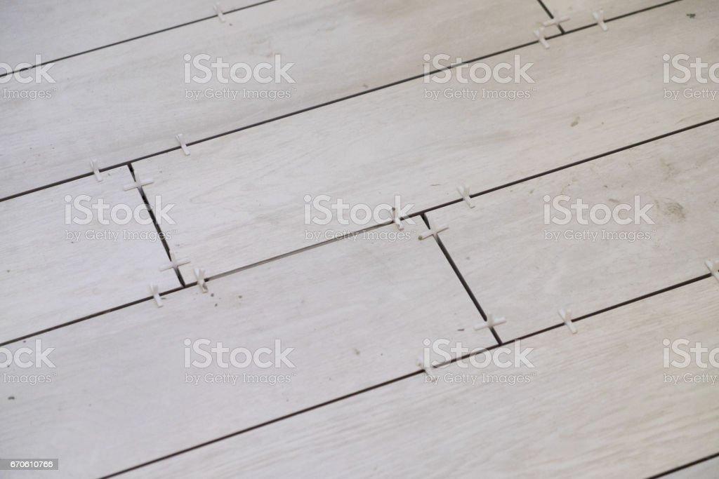 White Wood Grain Tiles at House Renovation stock photo