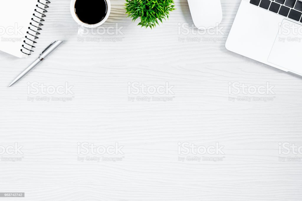 White wood office desk table and equipment for working with black coffee  in top view and flat ray concept. stock photo