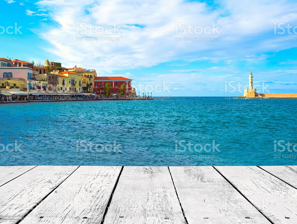 White wood plank and landscape with lighthouse stock photo