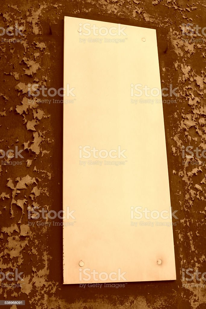 white wood plaque on the wall stock photo