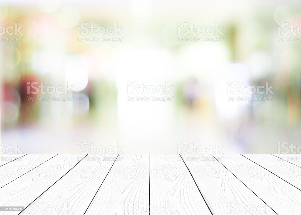 White Wood Table Surface With Bokeh Blurred Shop Interior Royalty Free  Stock Photo