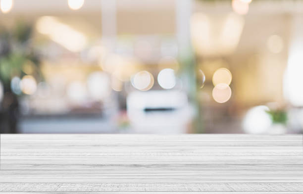 White wood table top with blurred defocus backgrounds stock photo