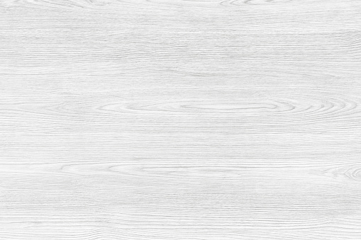 White wood background. A wood grain pattern featuring even grains of wood running horizontally across the image. The board is new and clean.