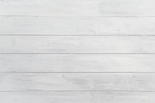 Wooden texture background tiles seamlessly in all directions. Full frame.