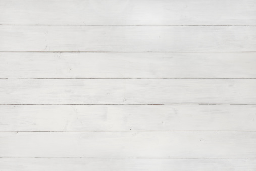 Wooden texture background tiles seamlessly in all directions. Full frame