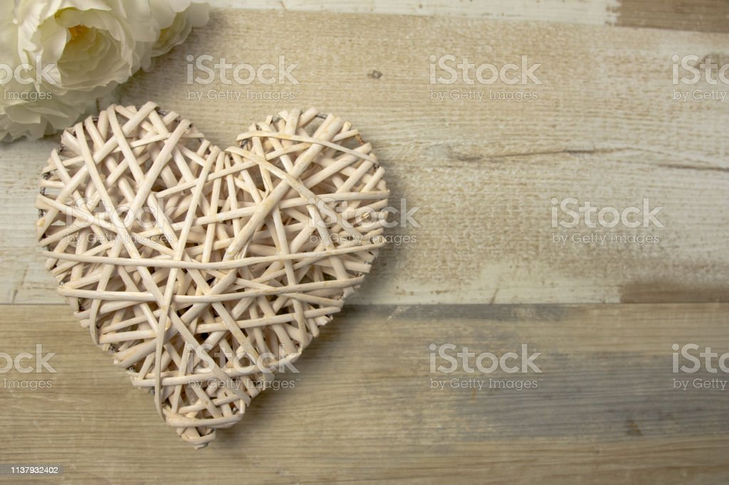 White Wood Wicker Heart On The Timber Wooden Background Stock Photo