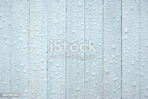 white wooden background with rain drops