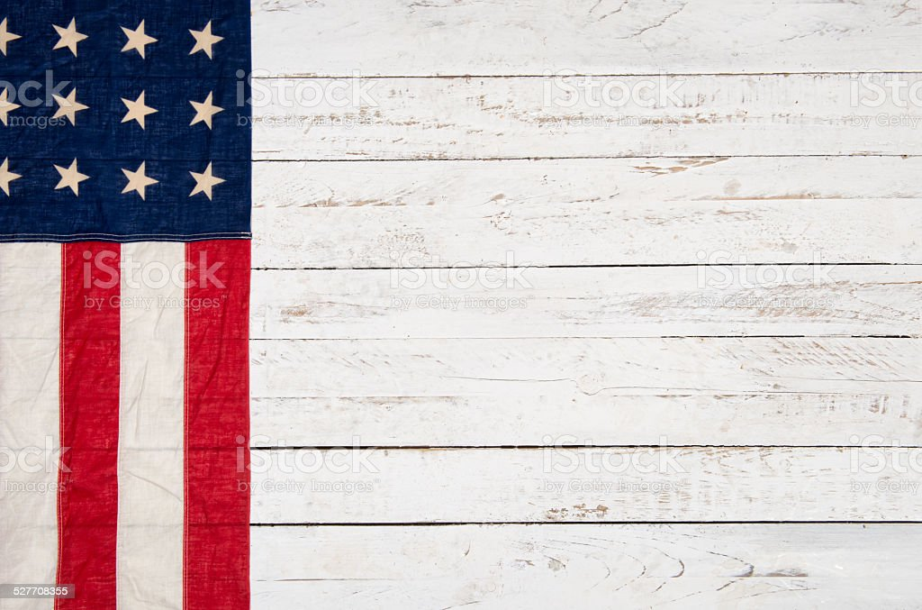 white wooden background with an American flag stock photo
