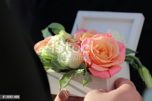istock White wooden box for rings with fresh flowers, 613561468