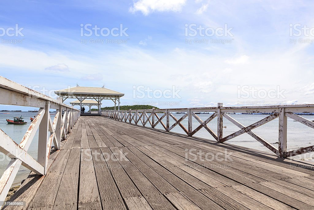 White wooden bridge into the sea royalty-free stock photo