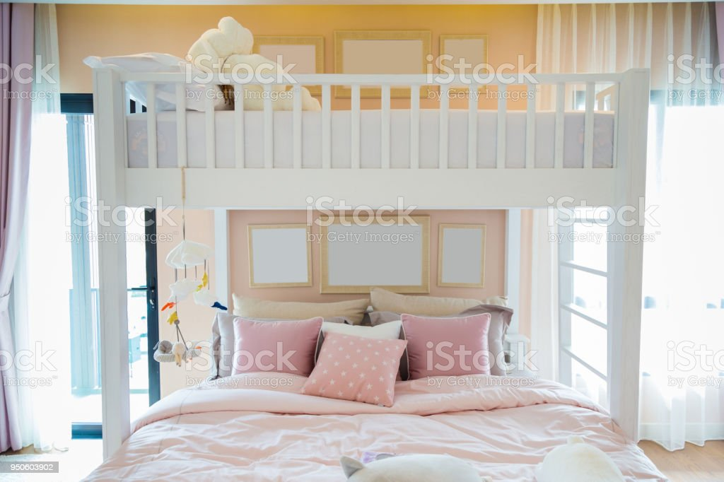 Picture of: A White Wooden Bunk Bed With A Pink Pillows And Frames On Wall In A Childrens Bedroom Stock Photo Download Image Now Istock