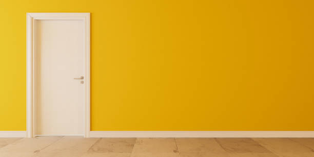 White wooden door with yellow wall and white stone floor 3D rendering stock photo
