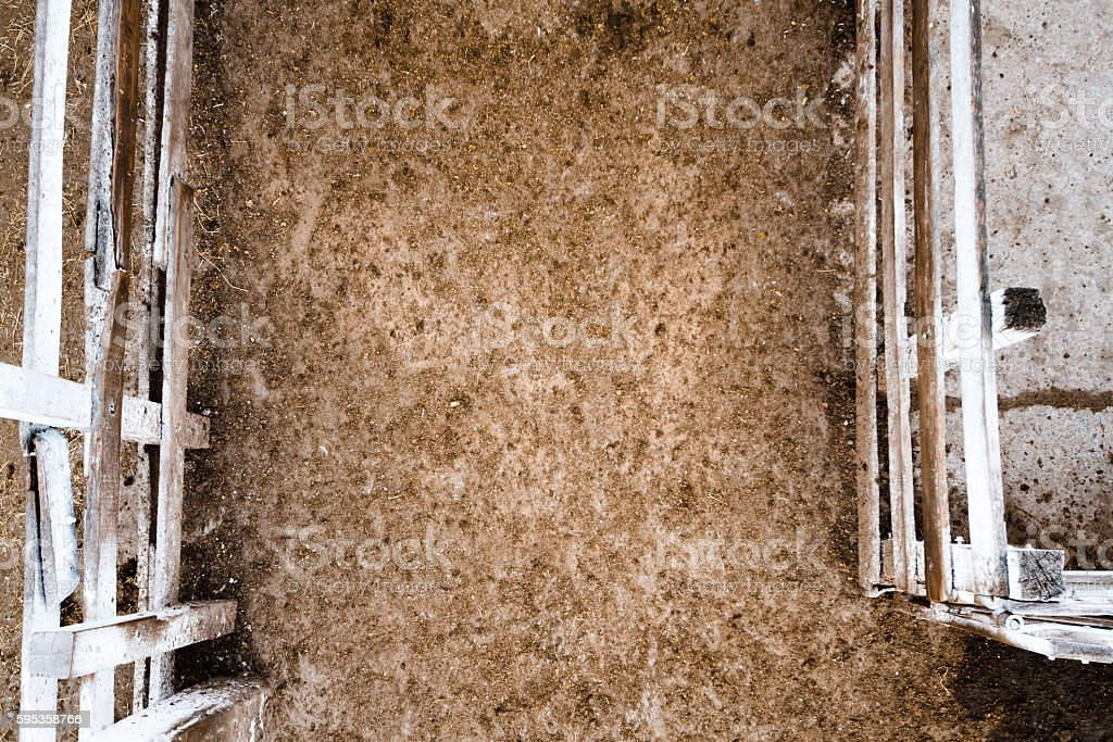 White wooden farm gate viewed from above with dirt road stock photo