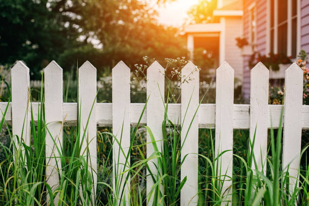White wooden fence at detached house backyard stock photo