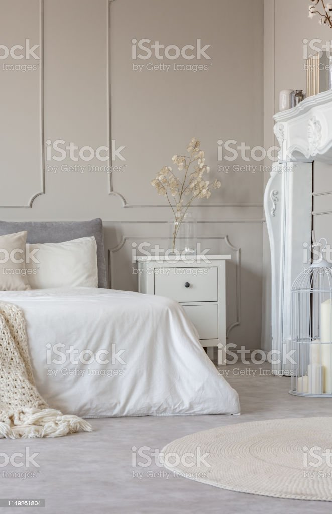 Picture of: White Wooden Fireplace Portal In Beautiful Bedroom Interior With White Sheets On King Size Bed Stock Photo Download Image Now Istock