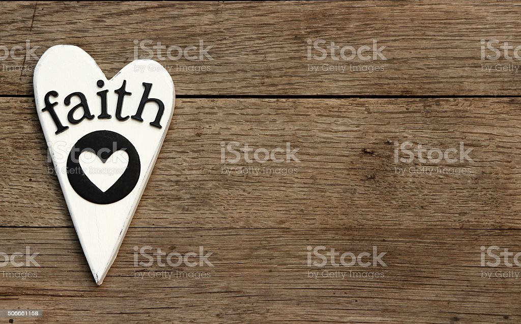 White wooden heart with Faith and heart cut out stock photo