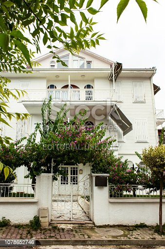 Istanbul, Turkey - June 22, 2015: It is one of the historical houses in Büyükada, the oldest of the prince islands in Istanbul. Mediterranean architecture is a historic white wooden building. Büyükada in Istanbul, Turkey.