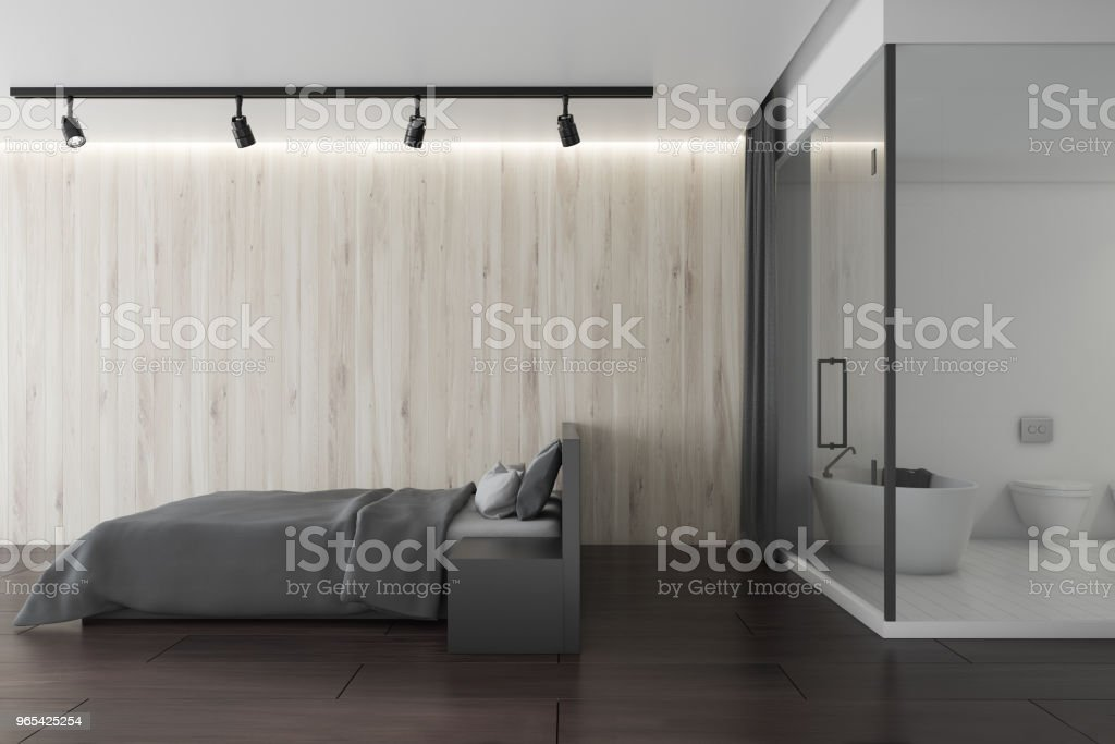 White wooden loft bedroom next to a shower stall zbiór zdjęć royalty-free