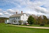 istock White wooden New England farmhouse 171296408